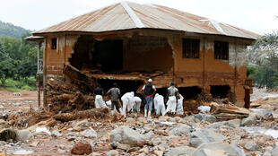 Rescue workers search through rubbles around a house for bodies at Pentagon, in Freetown, Sierra Leone on 18 August, 2017.