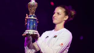 Karolina Pliskova hoisted the Qatar Open trophy after beating Caroline Wozniacki for the first time in her career.
