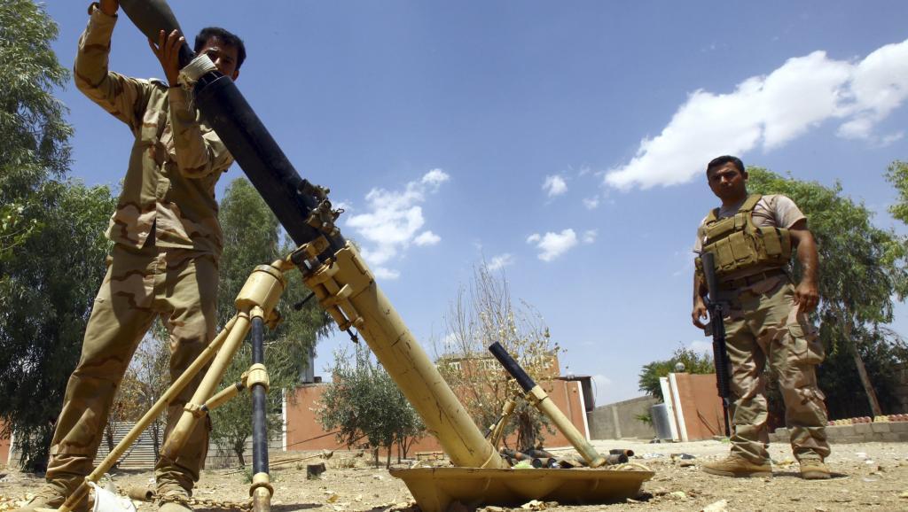 Wapiganaji wa kikurdi wakati wa maqpigano dhidi ya wapiganaji wa makundi ya kislamu nchini Iraq.