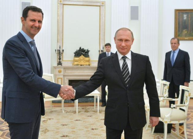 Rais wa Urusi Vladimir Putin na mwenzake wa Syria Bashar Al-Assad, Oktoba 21, 2015 Moscow.