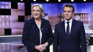 Emmanuel Macron (R) and Marine Le Pen (L) befor the debate