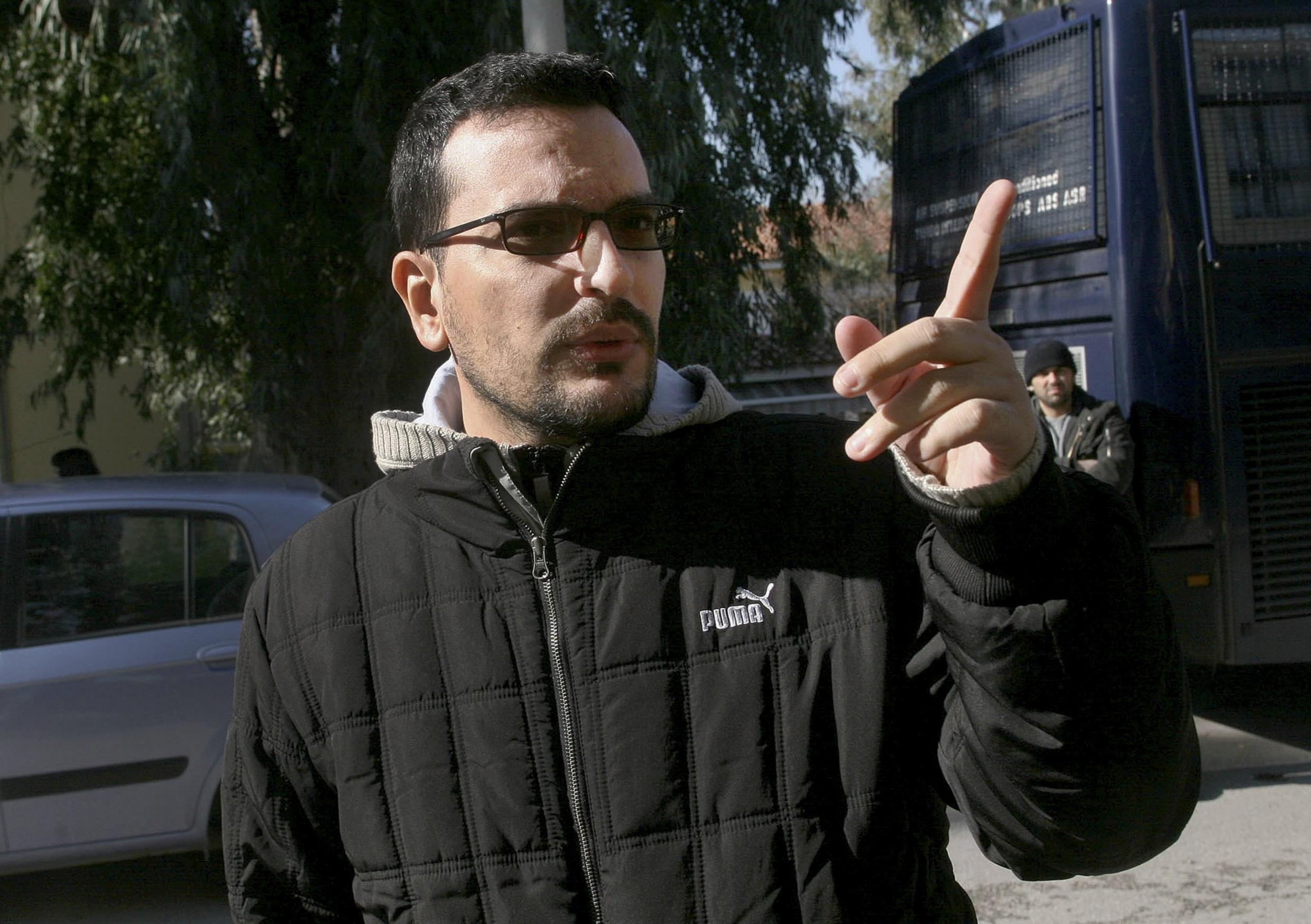 Journalist Socratis Guiolas gestures outside a courthouse in Athens in this undated file photo