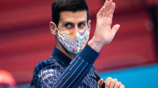 All over: Novak Djokovic waves to the crowd