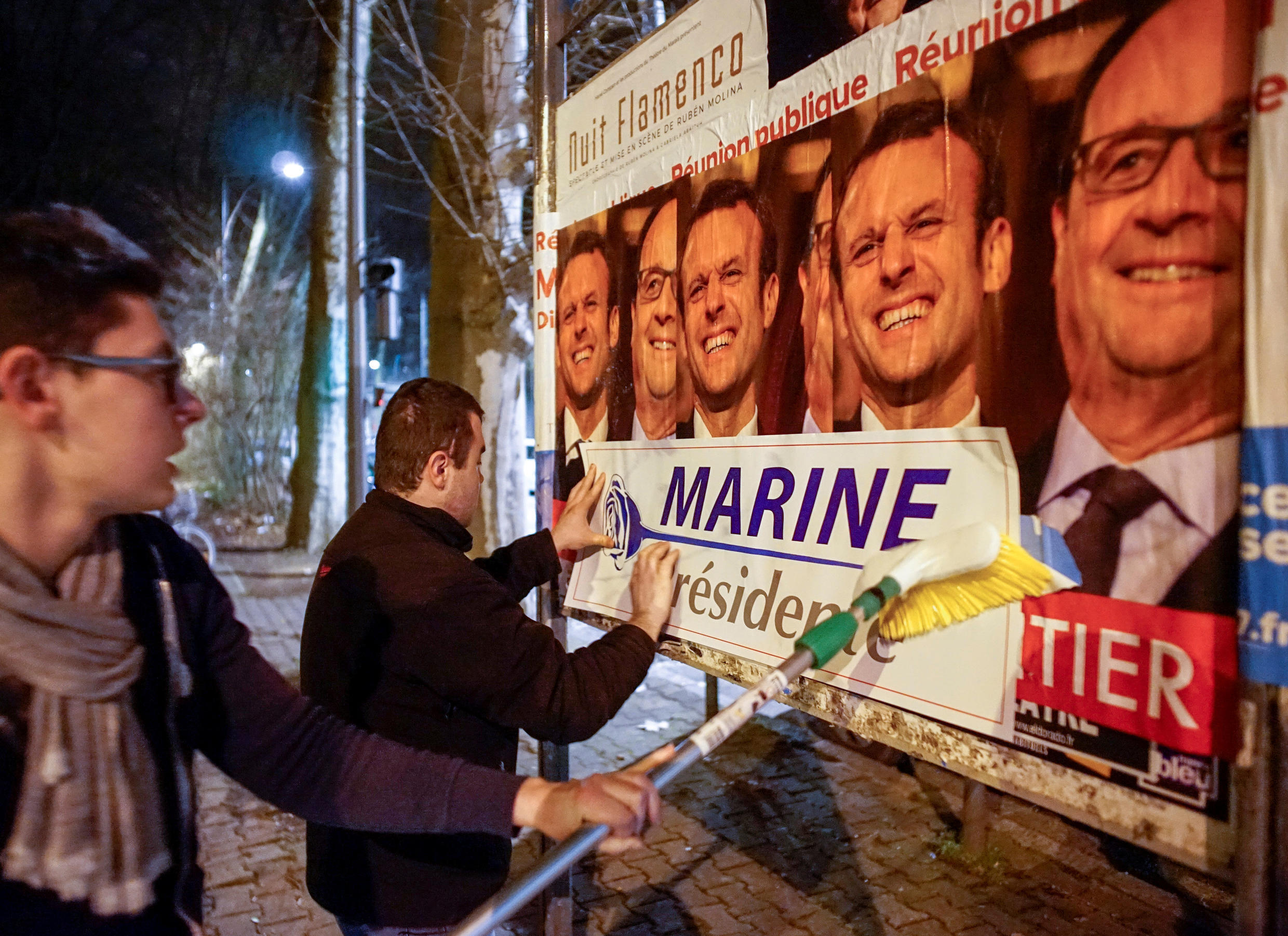 Members of the National Front youths put up posters of Marine Le Pen, French National Front (FN) political party leader and candidate for the French 2017 presidential election, ahead of a 2-day FN political rally to launch the presidential campaign in Lyon