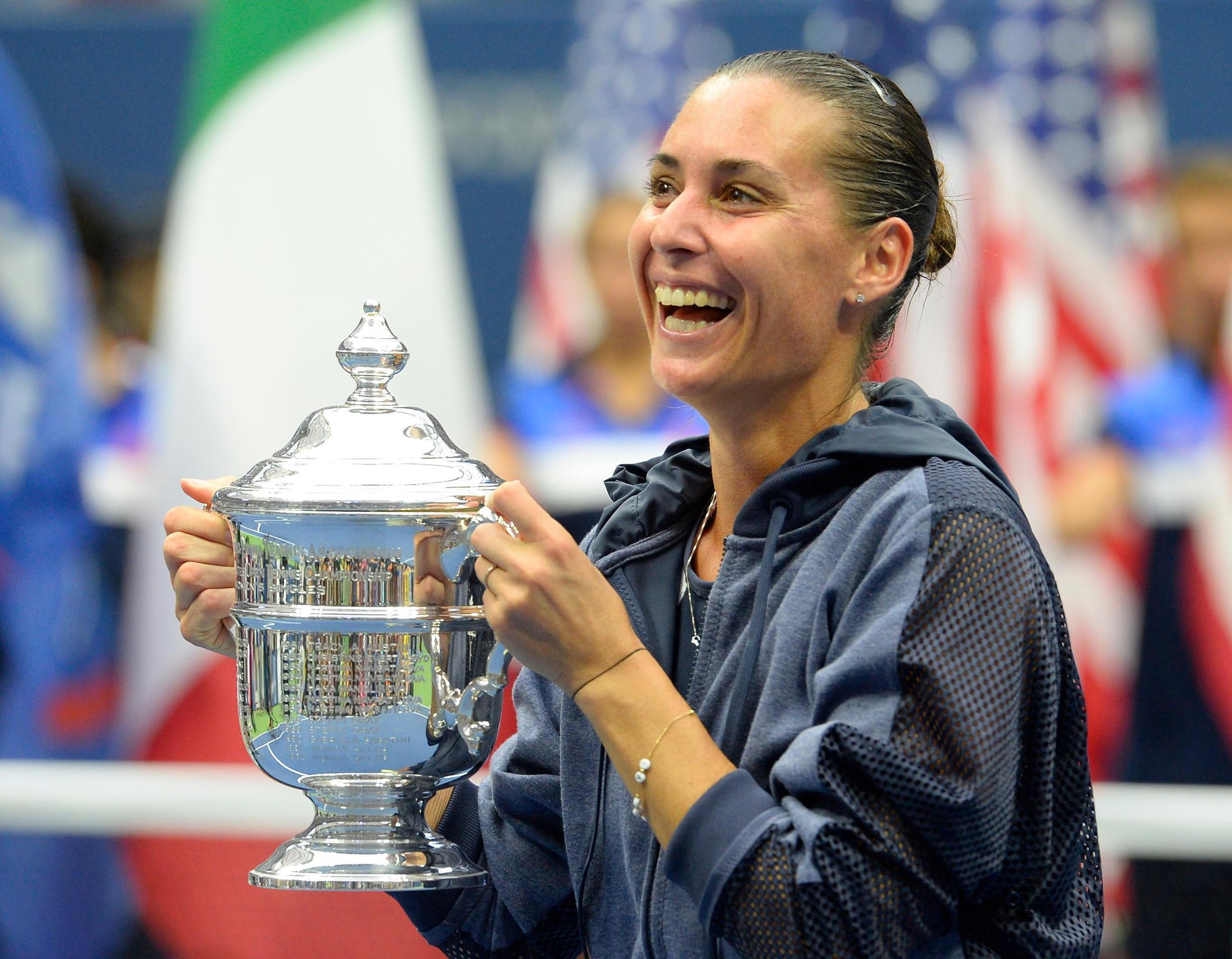 Flavia Pennetta celebrates with the US Open trophy after beating Roberta Vinci of Italy in the women's singles final on Saturday.