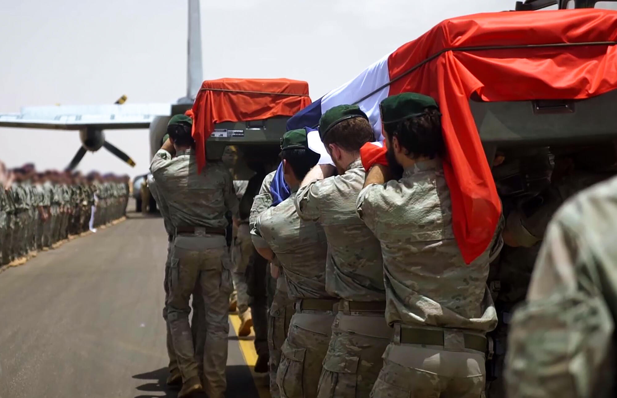 A French Arm video shows French soldiers of the counter-terrorism Barkhane mission carrying the coffins of Cedric de Pierrepont and Alain Bertoncello.  carrying the coffins,of their comrades