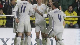 Wachezaji wa timu ya Real Madrid wakishangilia ushindi wa mabao 3-0 dhidi ya Atletico Madrid. .