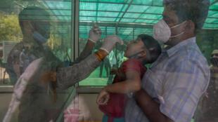 Inde - New Delhi - Covid-19 - Jeune - AP21105317283670