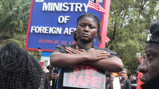 A Liberian anti-rape protester outside President George Weah's office at the ministry of foreign affairs in downtown Monrovia.