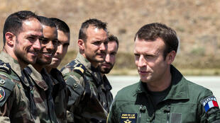 French President Emmanuel Macron in pilot's uniform visit an airbase at Istres last month