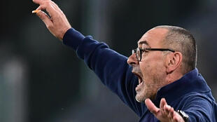Burning ambition: Maurizio Sarri conducts Juventus  by waving a cigarette butt from the sideline in an Italian Cup semi-final