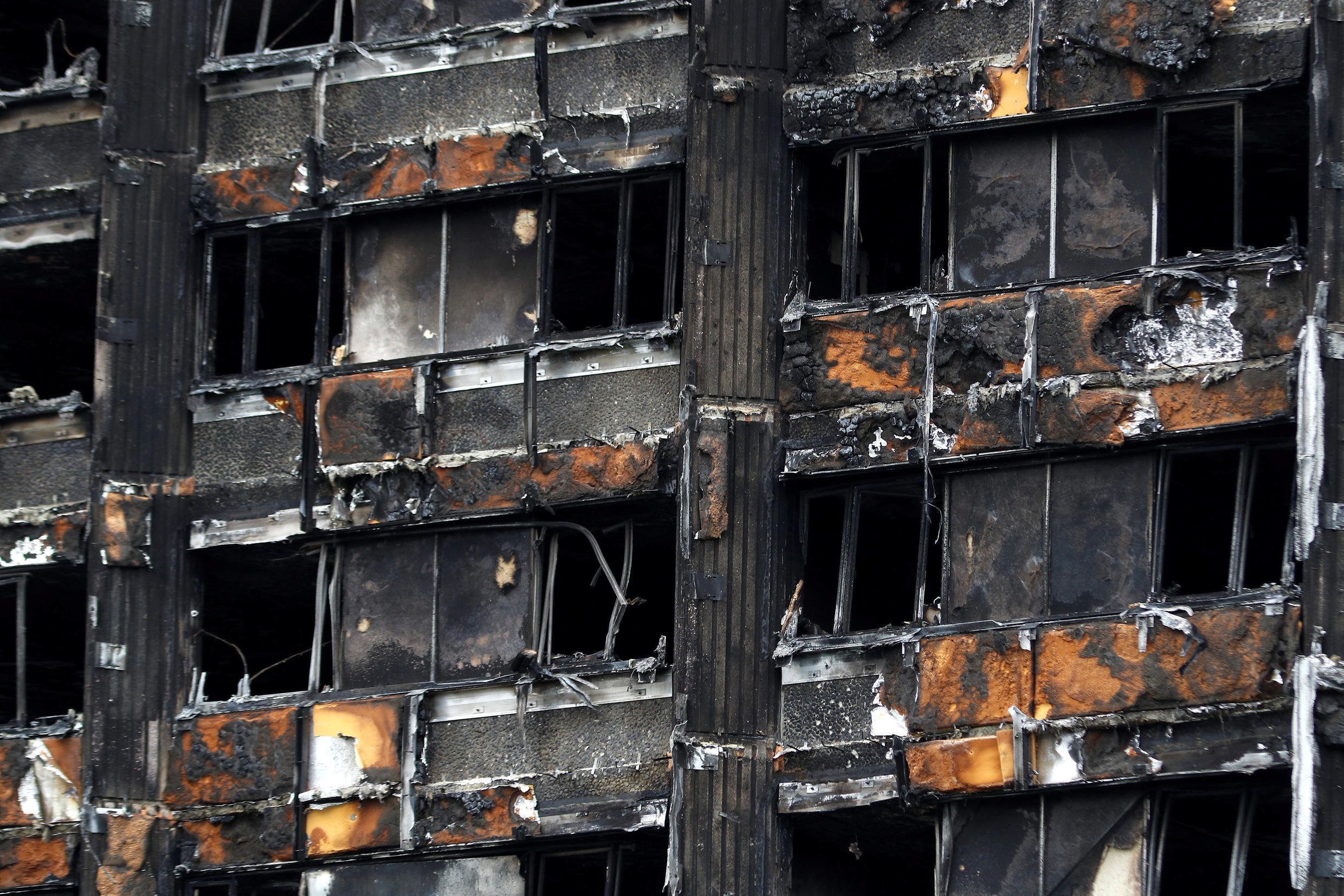 The scorched facade of Grenfell Tower after the blaze