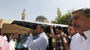 Mourners take part in a funeral for a victim killed in a blast in Umm al-Qura mosque