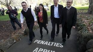 Australia's two major parties are wooing independent lawmakers like Greens MP Adam Brandt (far right),
