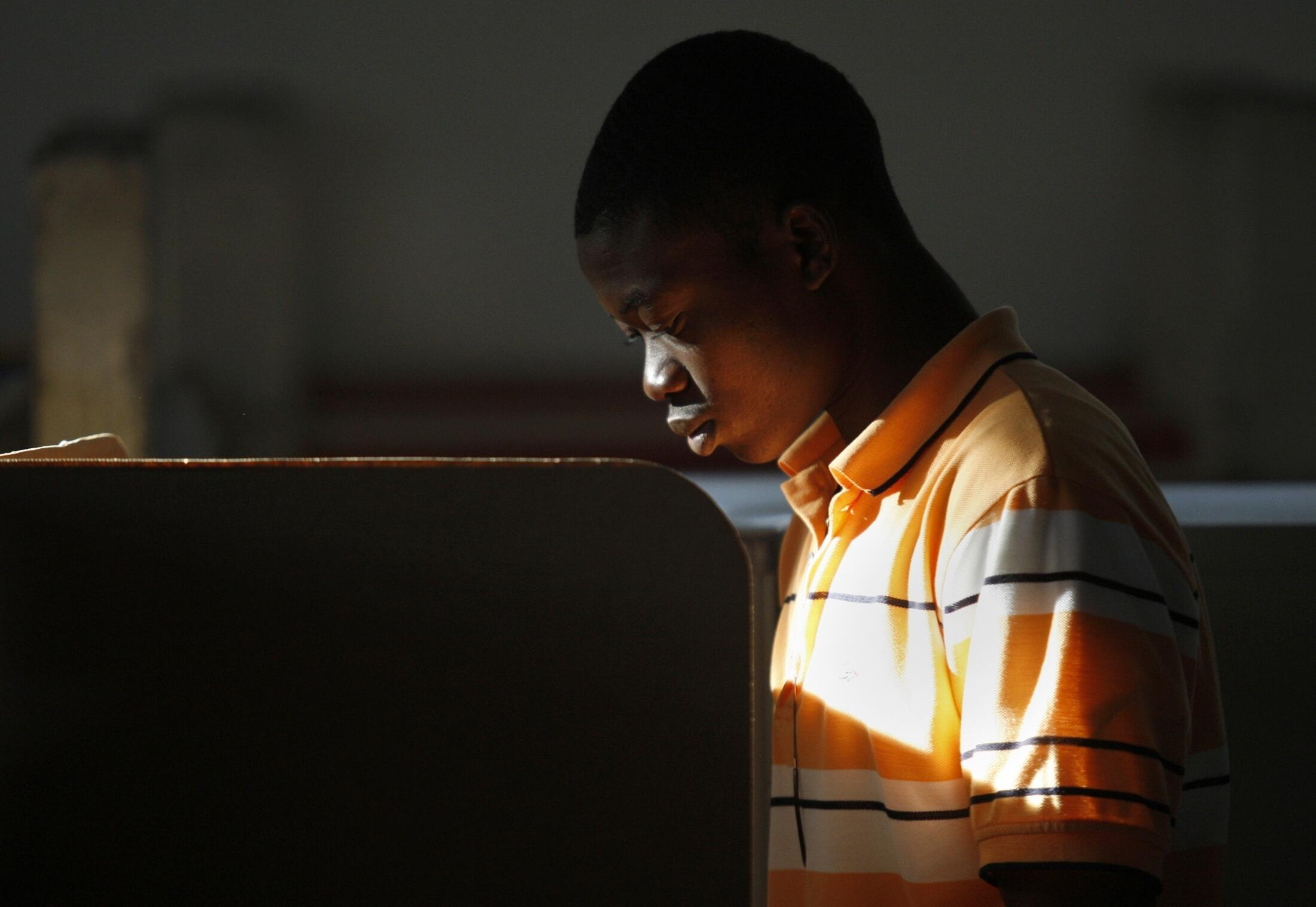 A man casts his vote in a voting centre in downtown Port-au-Prince