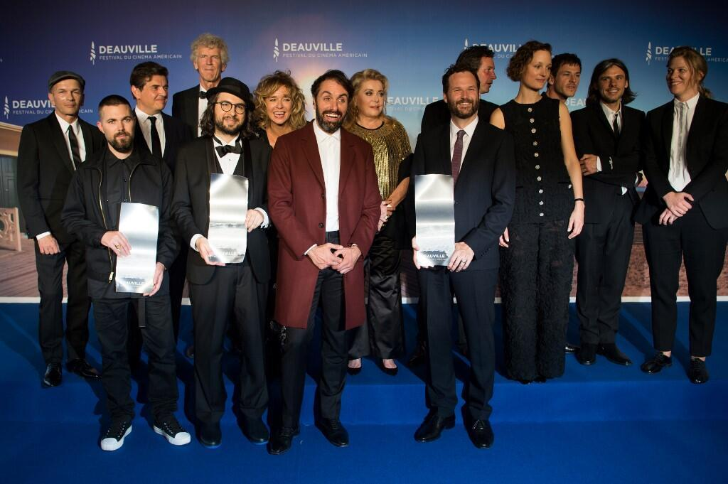 Front row winners of Deauville American Film Festival awards. L to R Robert Eggers, Carlo Mirabella-Davis, Michael Angelo Colvino, Kyle Marvin. In background the jury headed by Catherine Deneuve, Deauville, 14 September 2019