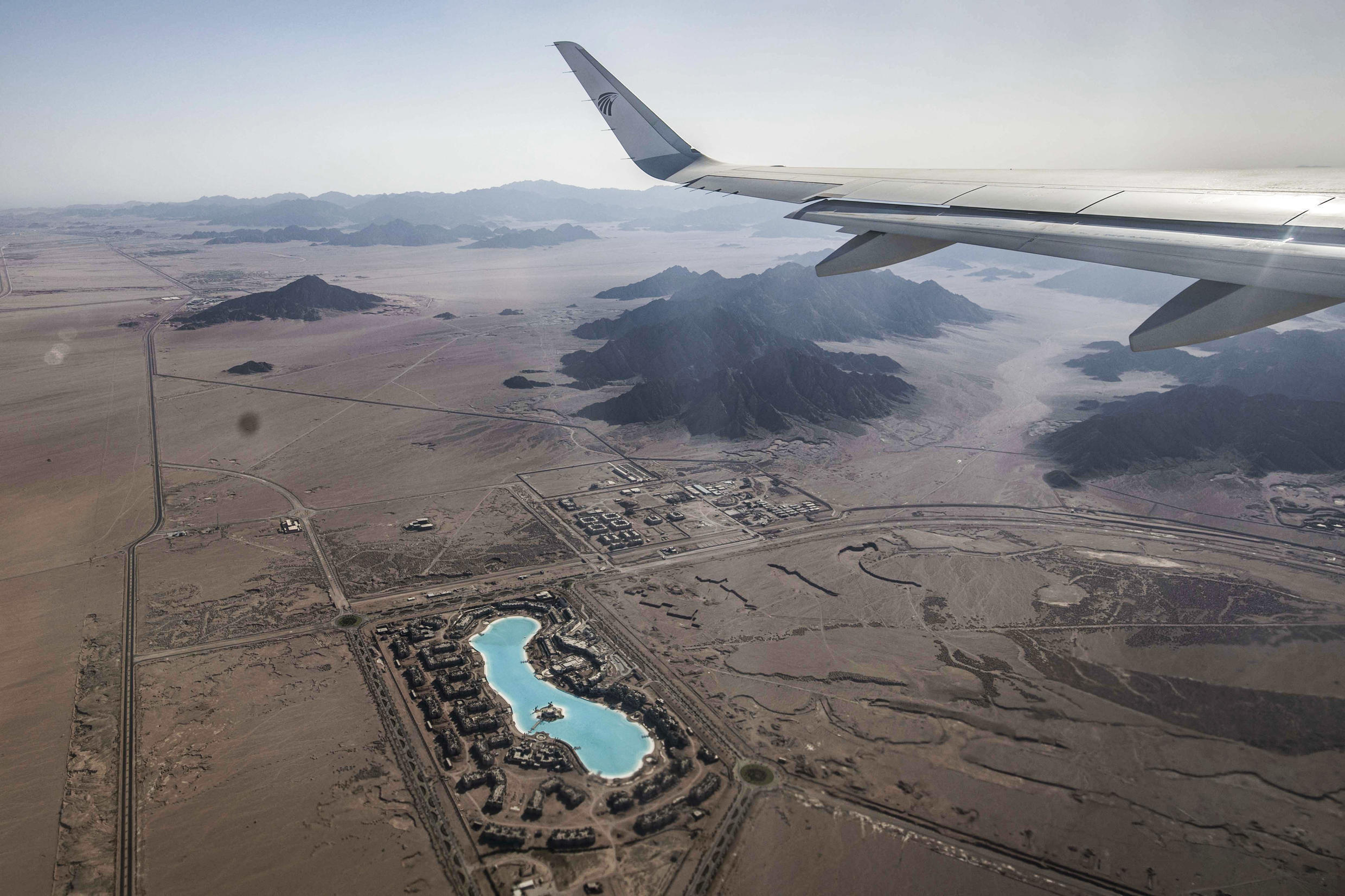 A plane passes over a Sharm el-Sheikh resort near the southern tip of the Egypt's Sinai peninsula in June of this year