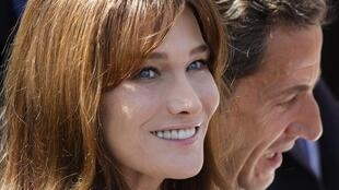 Carla Bruni-Sarkozy, ex-supermodel and French first lady, current folk singer, wife of Nicolas Sarkozy (r.) and mother of 3-year-old Giulia.