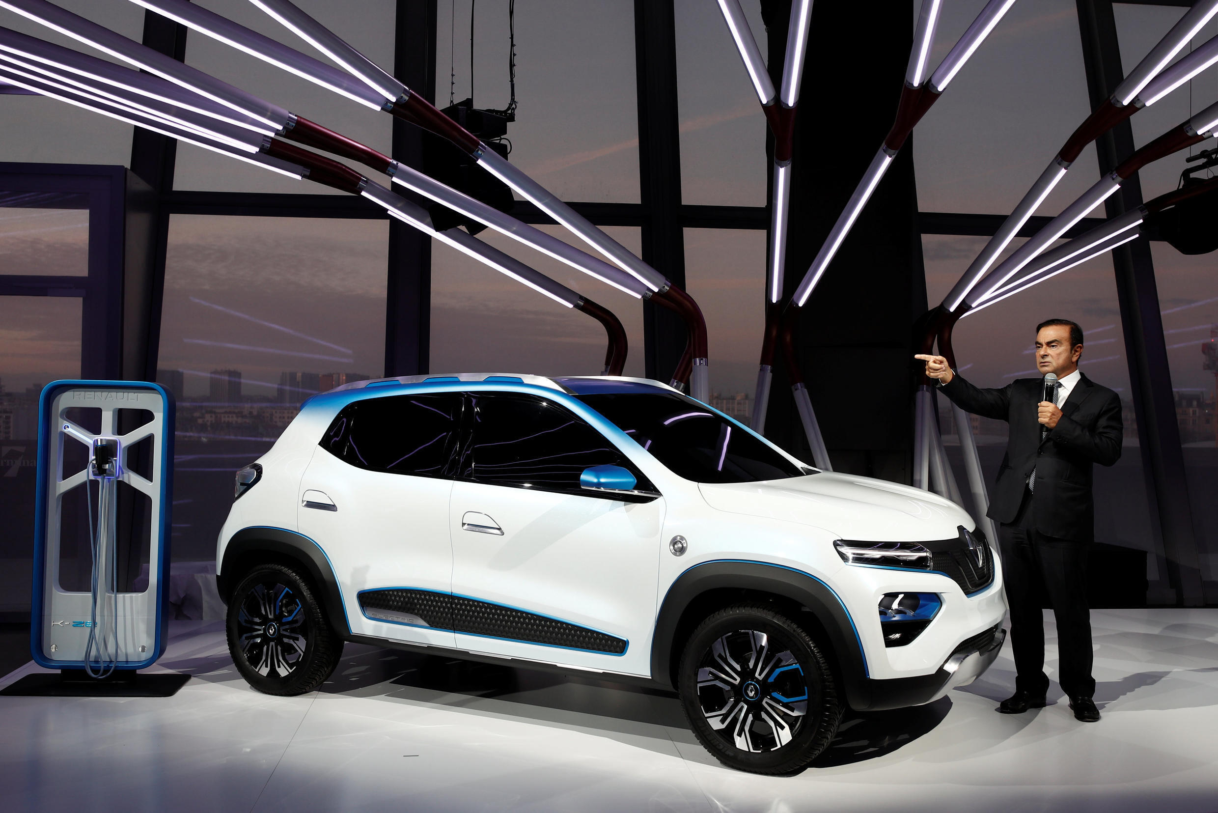 Carlos Ghosn, Chairman and CEO of the Renault-Nissan Alliance, speaks next to an electric show car called Renault K-ZE at the Paris Motor Show on 1 October 2018.