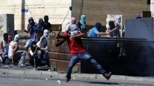 Đụng độ giữa những người đưa tang thanh niên Palestine bị sát hại và cảnh sát  Israel trong ngày 04/07/2014 tại Jerusalem.