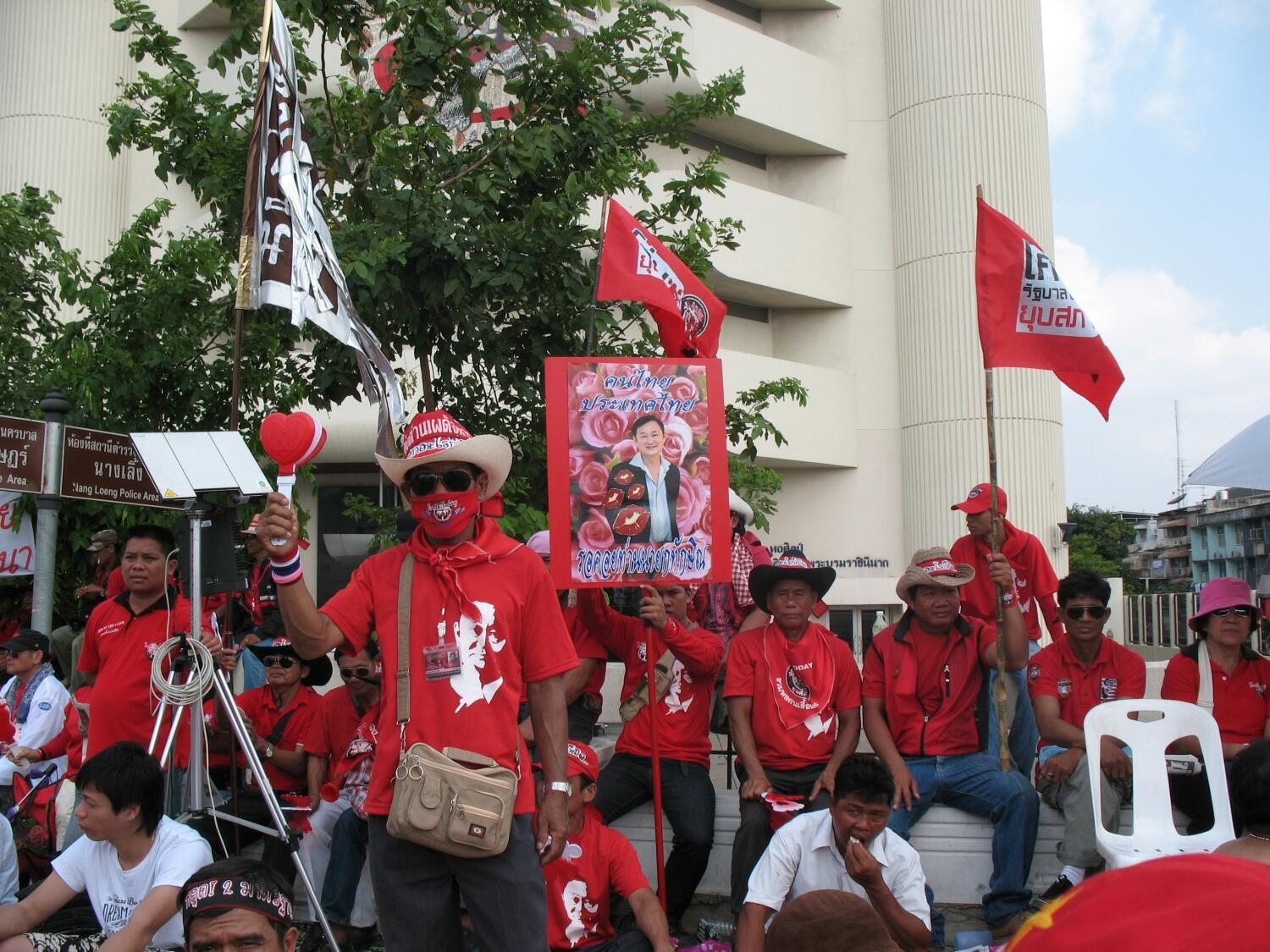 Red Shirt protesters in front of a picture of former prime minister Thaksin Shinawatra.