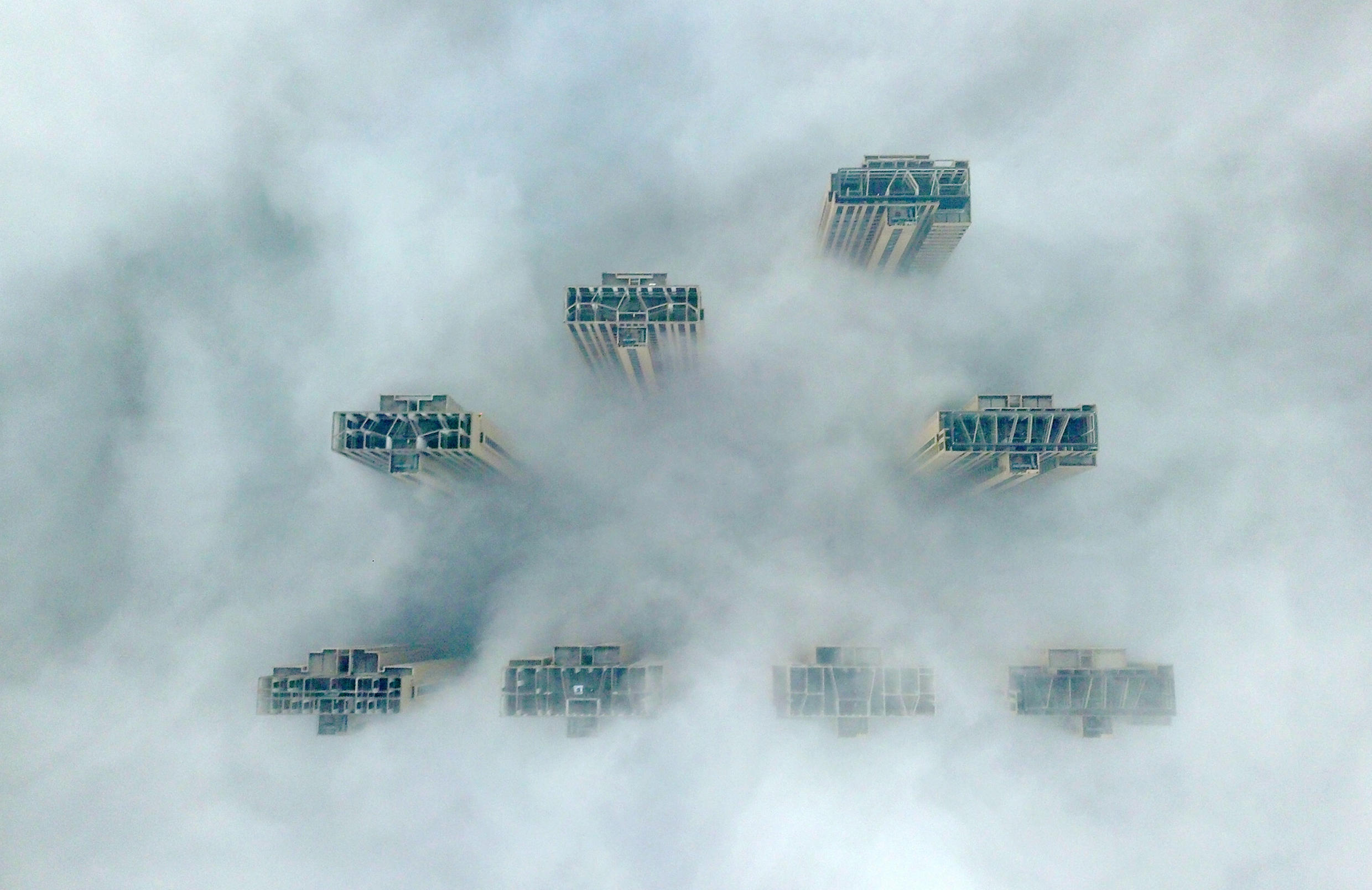 This aerial view shows the tops of highrise buildings poking out from heavy fog in Yangzhou, in China's eastern Jiangsu province on January 14, 2019.