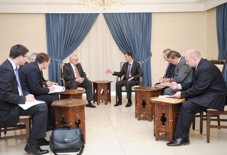 Bashar al-Assad with Russian deputy Foreign Minister Sergei Ryabkov in Damascus, 18 September 2013