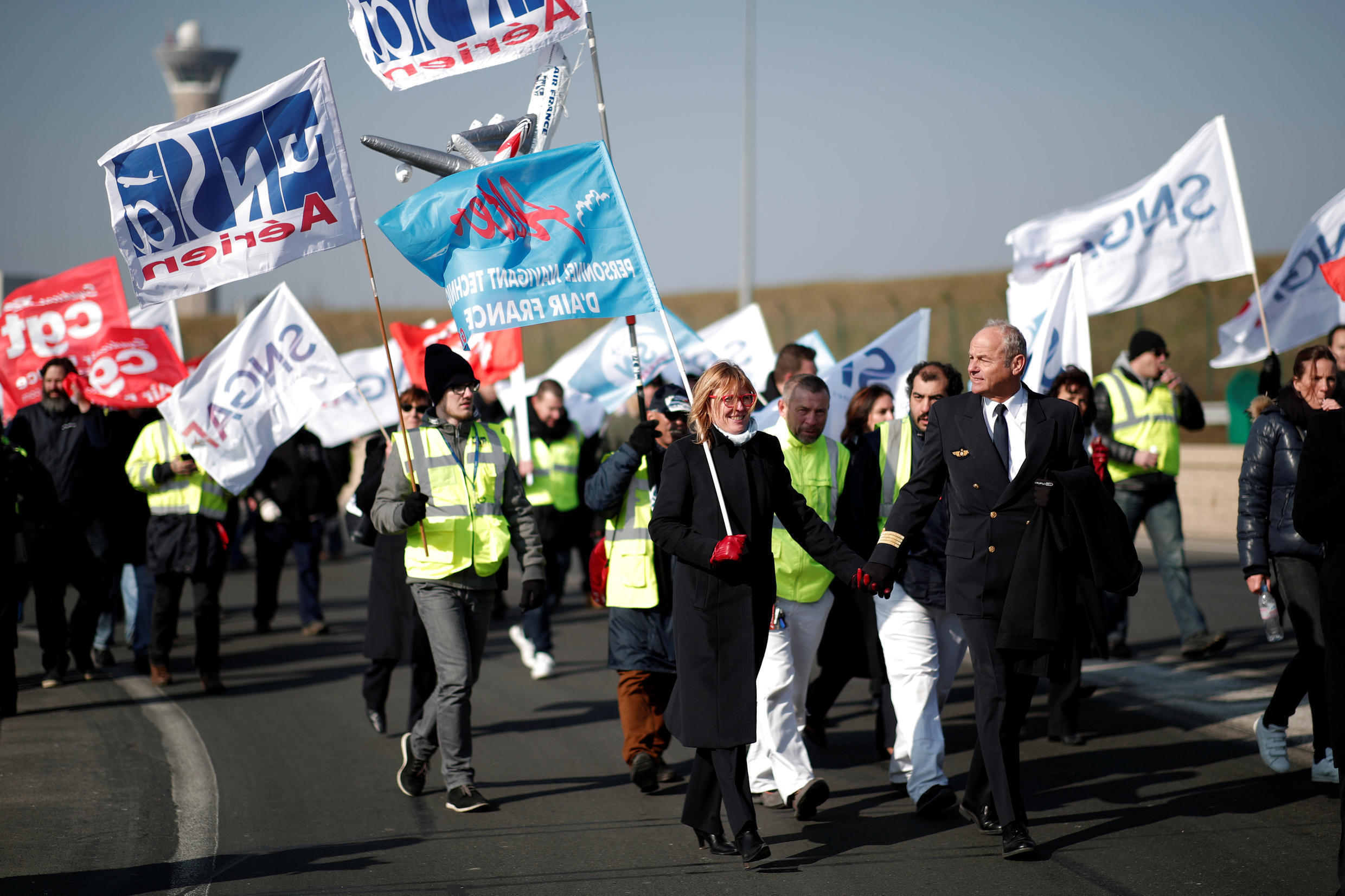Air France employees demonstrate outside the Charles-de-Gaulle airport in February