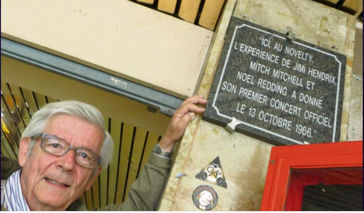 Alain Lambert in front of the plaque in Evreux, commemorating the Jimi Hendrix Experience concert on 13 October 1966.