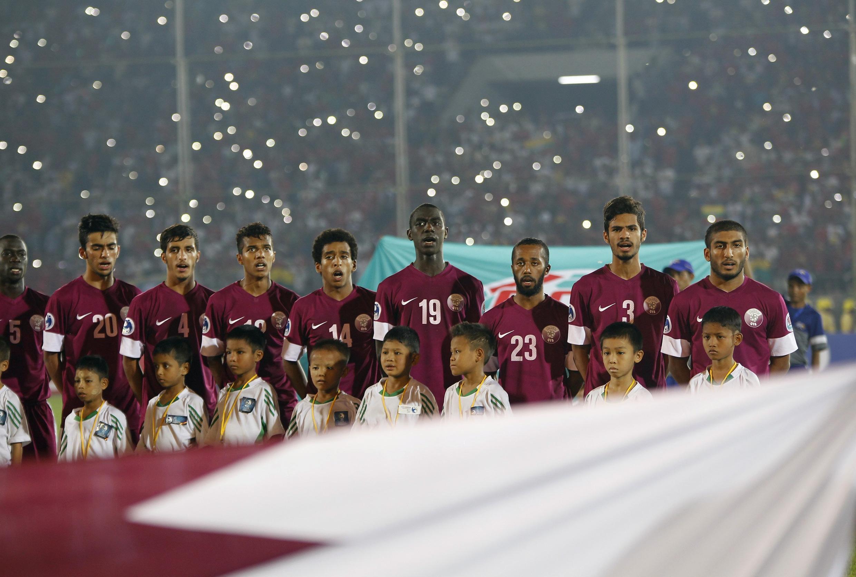 L'équipe du Qatar de football chantant l'hymne national.