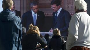 Obama encontra o primeiro-ministro holandês, Mark Rutte (à direita), na manhã desta segunda-feira (24) em Amsterdam.