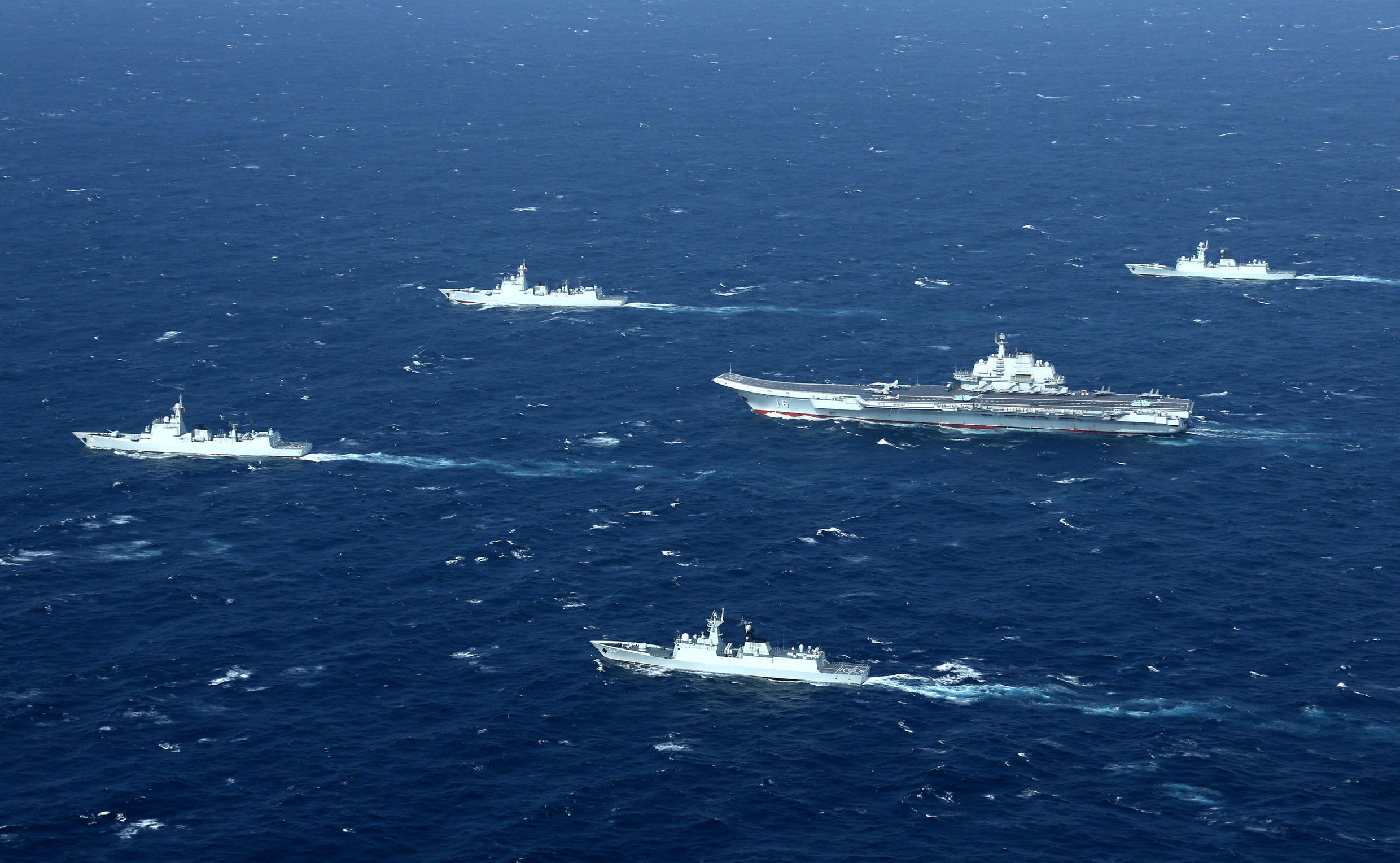 China's Liaoning aircraft carrier with accompanying fleet conducts a drill in an area of South China Sea in this undated photo taken December, 2016. REUTERS/Stringer