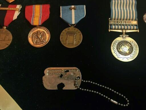 The identity tag and medals belonging to Army Master Sergeant Charles McDaniel, who went missing during the Korean War
