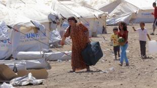 Des réfugiés syriens au Kurdistan, dans le camp d'Arbil, à quelque 350 km au nord de Bagdad, le 16 août 2013.