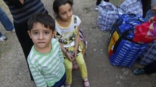 Roma children at Bucharest airport after being deported from France