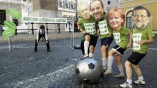 Manifestantes usam máscaras que fazem alusão aos líderes (da esq. para a dir.) Mario Monti, François Hollande, Angela Merkel e Mariano Rajoy.