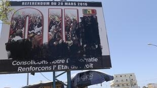 A damaged board announcing the referendum on the constitutional revision in Guediawaye suburb in Dakar