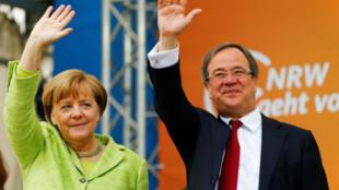 德國總理默克爾與基民盟新任主席拉舍特資料圖片