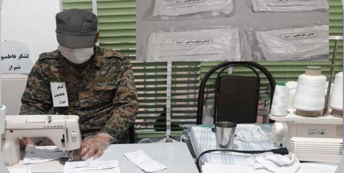 """یک عضو افغان """"لشگر فاطمیون"""" در حال دوختن ماسک در یکی از کارگاه های سپاه پاسداران در شیراز."""