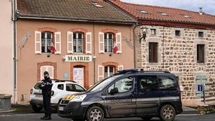 The city hall in Saint-Just, central France, on Wednesday as security forces locked down the area after a man shot and killed three officers.