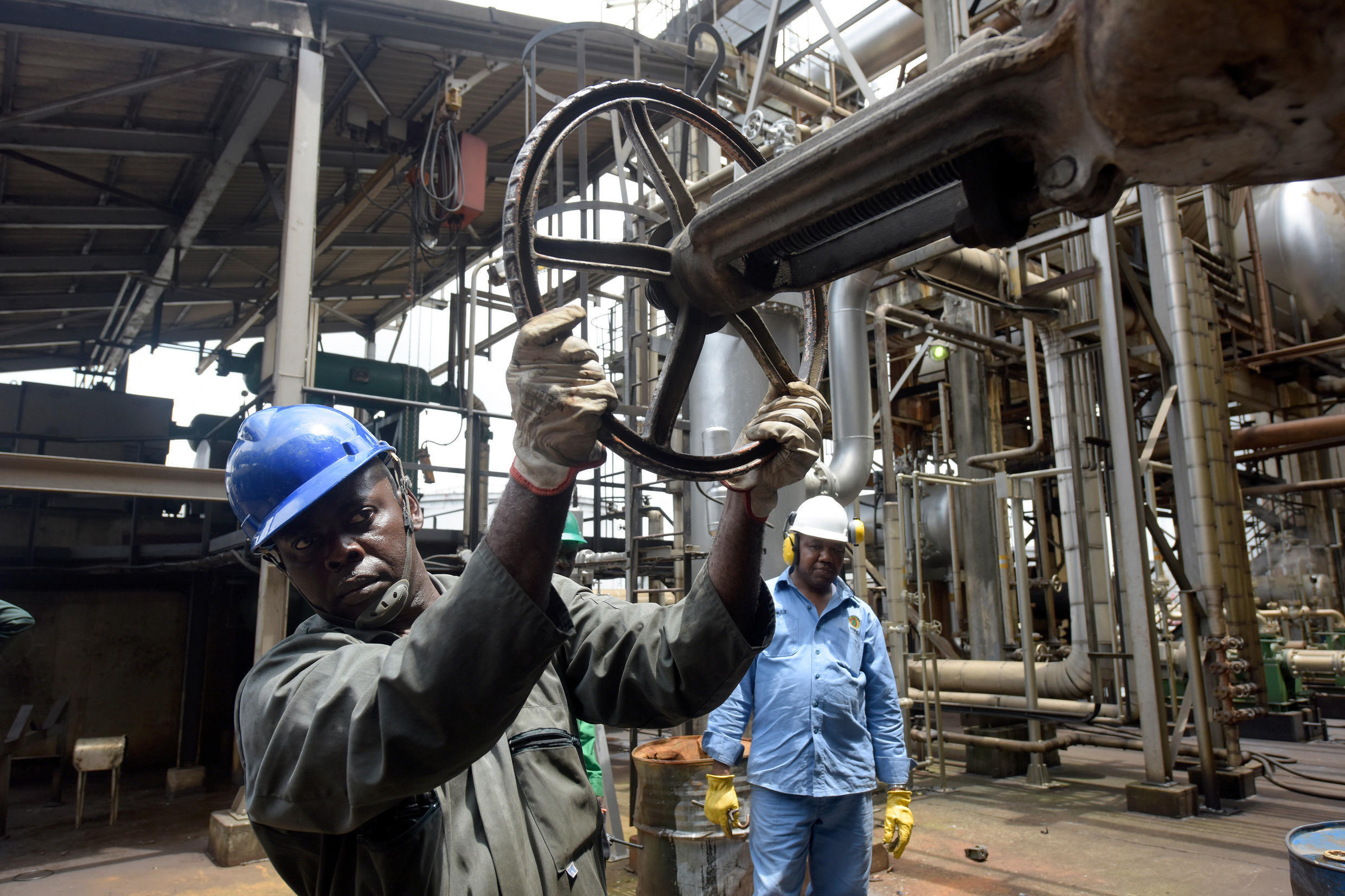An oil worker controls a valve at the Port Harcourt refinery.