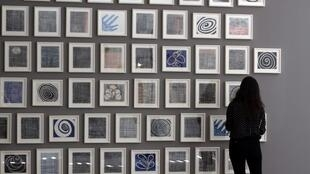 """A woman looks at """"Je t'aime"""" (2005), a series of 60 double-sided drawings by Louise Bourgeois, at Glenstone museum in Potomac, Maryland, United States."""