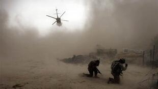 A US helicopter takes off at an outpost near Kandahar, where two soldiers were wounded Friday