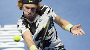 Fourth title: Andrey Rublev returns the ball to Borna Coric in Sunday's final