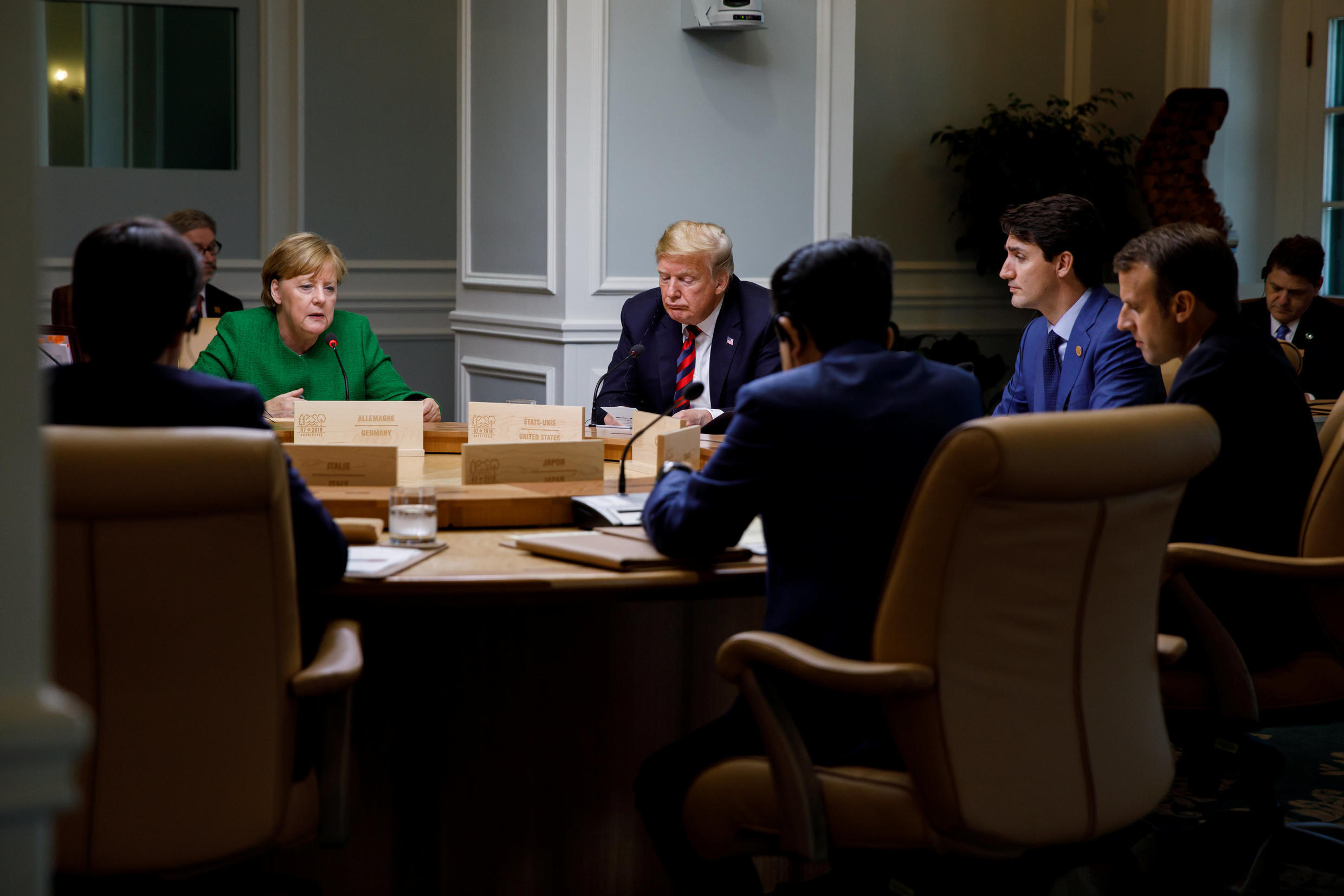 Canada's Prime Minister Justin Trudeau and G7 leaders France's President Emmanuel Macron, Germany's Chancellor Angela Merkel, Japan's Prime Minister Shinzo Abe and U.S. President Donald Trump take part in a working session on the first day of the G7 meetin