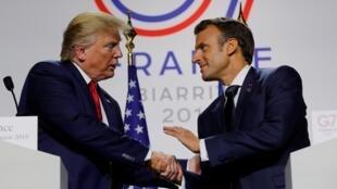 特朗普与马克龙出席七国集团峰会结束时的记者会。
