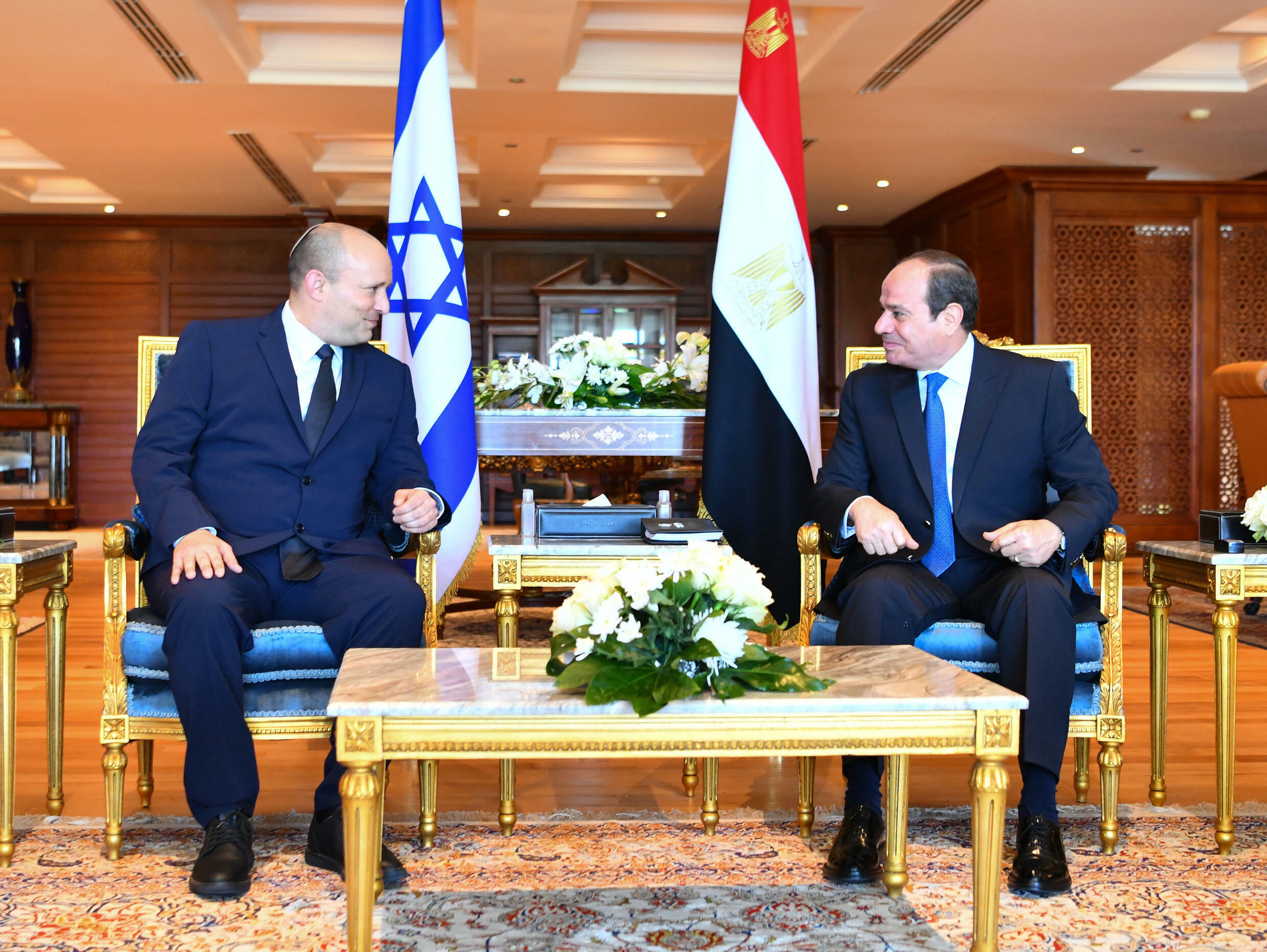 A picture released by the Egyptian presidency shows  President Abdel Fattah al-Sisi, on the right, meeting with Israeli Prime Minister Naftali Bennett in the Egyptian Red Sea resort town of Sharm El-Sheikh