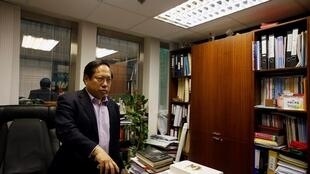 Pro-democracy lawmaker and lawyer Albert Ho ponders a question in his office in Hong Kong June 24, 2013.