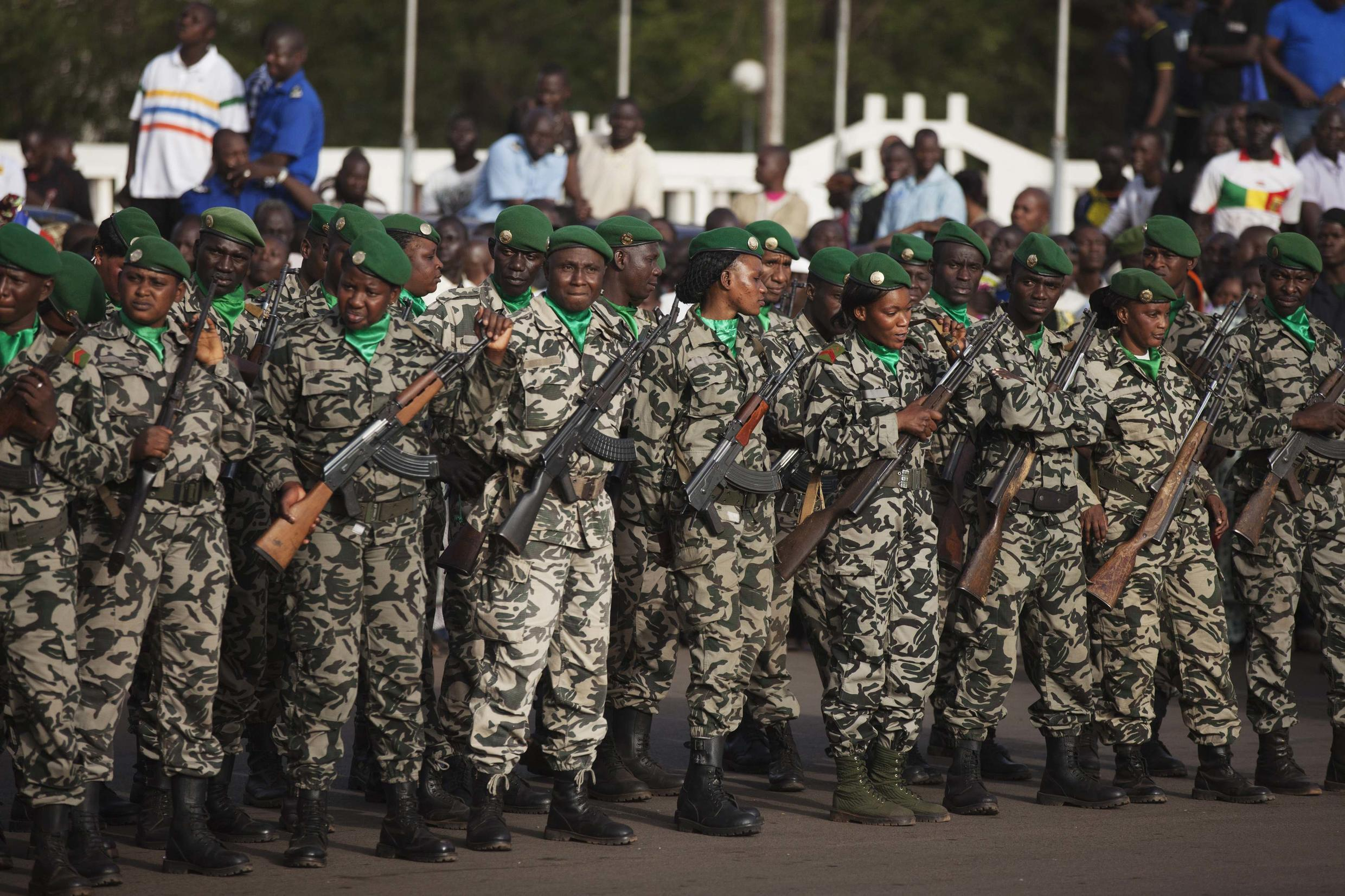 Malian soldiers stand guard before the arrival of France's President Francois Hollande at Independence Plaza in Bamako, Mali February 2, 2013.