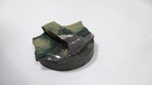 یکی از قطعاتی که به ادعای آمریکاییها از انفجار کشتی ژاپنی به دست آمده است